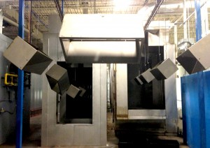 hanging metal products going down production line