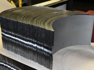 bent metal stacked next to each other