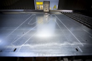 active laser cutter being used to cut metal components