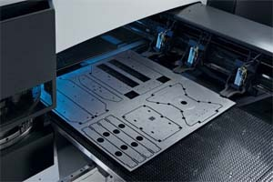 turret punched sheet enclosure features embosses